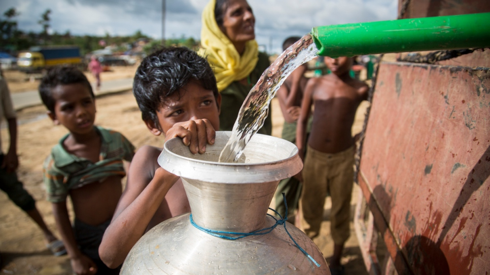 A Rohingya boy fills a water jug from a pipe at Kutupalong refugee camp in Bangladesh on October 6 2017.