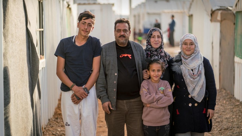 Syrian refugee Ehsan Al Khalili, his wife Rabab and three of their children stand outside their shelter in Jordan's Azraq refugee camp.