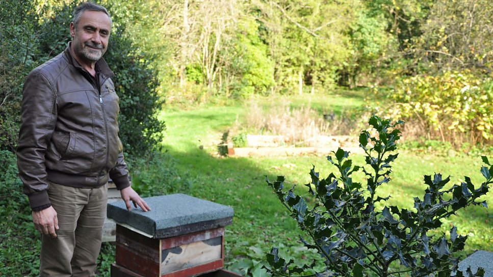 ​Ryad Alsous with one of his hives in the orchard at Armitage Bridge, Yorkshire.