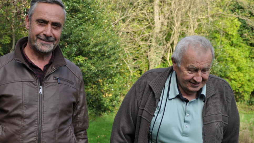 ​Ryad Alsous (left) with orchard owner ​Ted Mankowski in Armitage Bridge, Yorkshire.