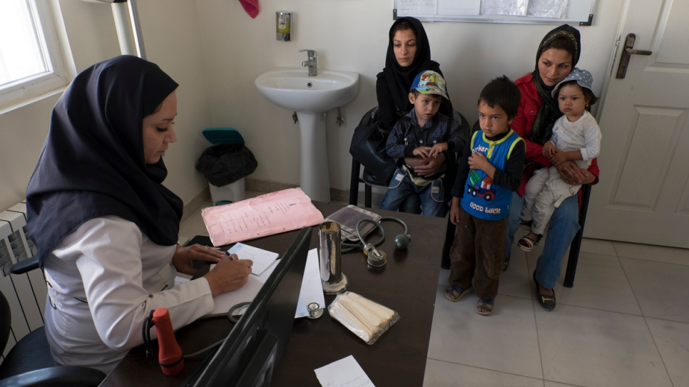 An Iranian doctor visits Afghan refugees at a health centre in Savejbolagh in Alborz province northwest of Tehran.