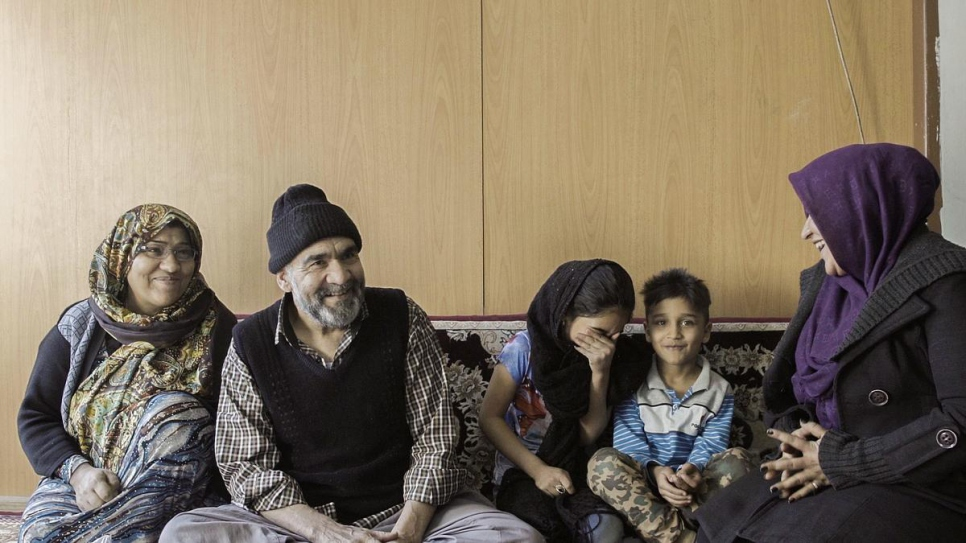 An Afghan refugee family who benefits from the Universal Public Health Insurance scheme.