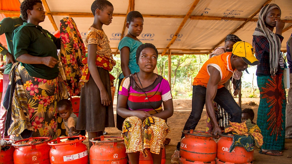 Burundian refugee Frida Nehebauwayo, 17, queues to receive an LPG cylinder.