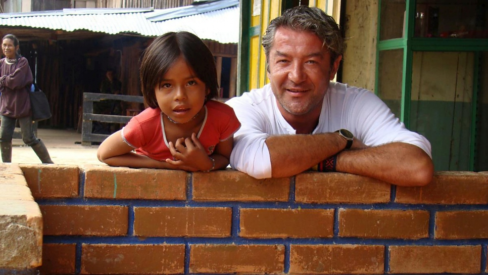 Roberto Mignone visits with a Siona indigenous child in Colombia's southern region of Putumayo in 2008.