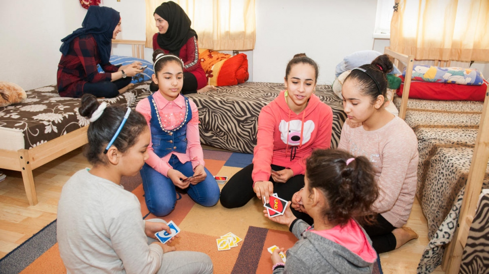 The Al-Bashawat daughters talk and play contentedly at their new home in Vienna, after completing the reunification process.