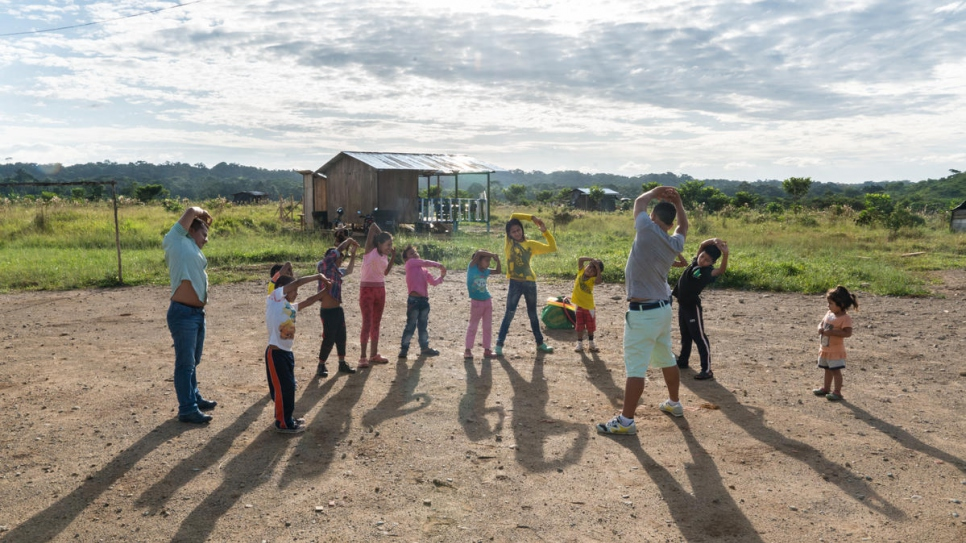 Children play a game during a physical education class. Once a week, a social worker from the municipality comes to the settlement to create special activities for the children.