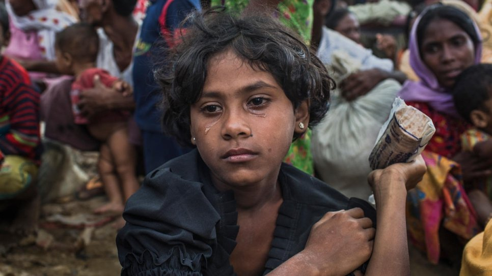 Umme Salma, 8, sits in tears after walking 10 kilometres from Myanmar to Kutupalong. Umme's parents were killed when their village was attacked. Both she and her sister are being cared for by their aunt, Rabiaa Khatun, who is 18.
