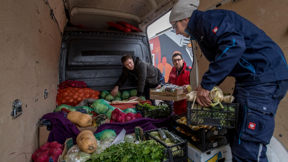 Volunteers deliver boxes of vegetables from Wiener Tafel to charities.