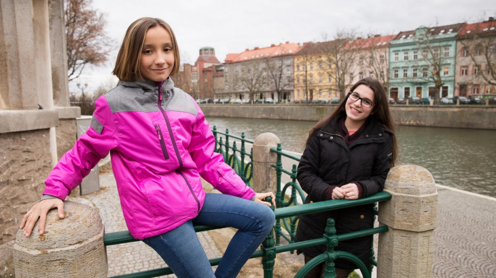 Syrian refugee Natalia Rami Haddad, 14 (right) and her Czech friend Natalie Sembdnerova, 12, take a stroll in Hradec Kralove, Czech Republic.
