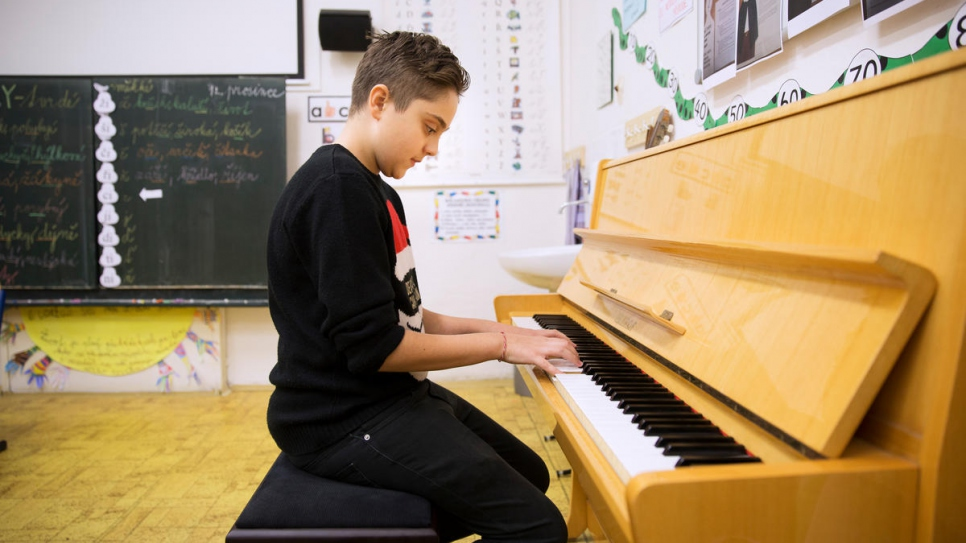 Syrian refugee Michel Barakat, 14, practises the piano in his high school, Bohuslav Balbin Episcopal Gymnasium, in Hradec Kralove, Czech Republic.