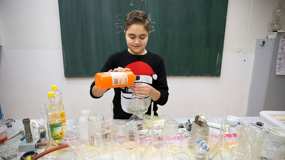 Syrian refugee Michel Barakat, 14, works in the chemistry lab at his high school, Bohuslav Balbin Episcopal Gymnasium in Hradec Kralove, Czech Republic.