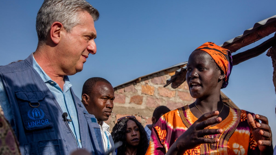 UNHCR chief Grandi meets South Sudan refugee Betty Zekiria Valeriano, 24, during his visit to Kakuma where she has a permanent shelter in Kalobeyei settlement.