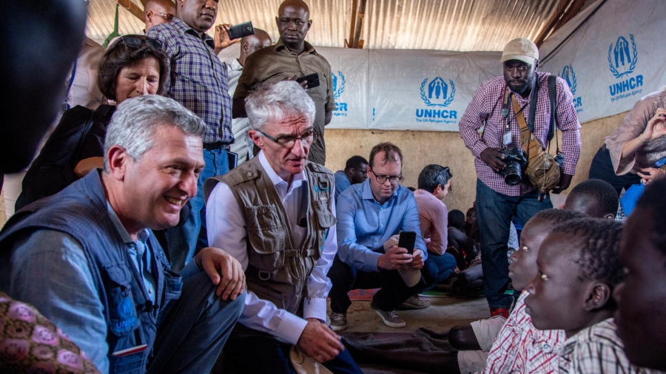 Jacob and Simon meet Filippo Grandi and UN Under-Secretary-General for Humanitarian Affairs, Mark Lowcock, at Kakuma and recount their suffering.
