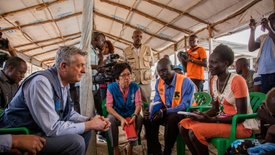 UNHCR head Filippo Grandi talks with refugees at Imvepi refugee settlement during a visit to Uganda to where 500 refugees flee every day.