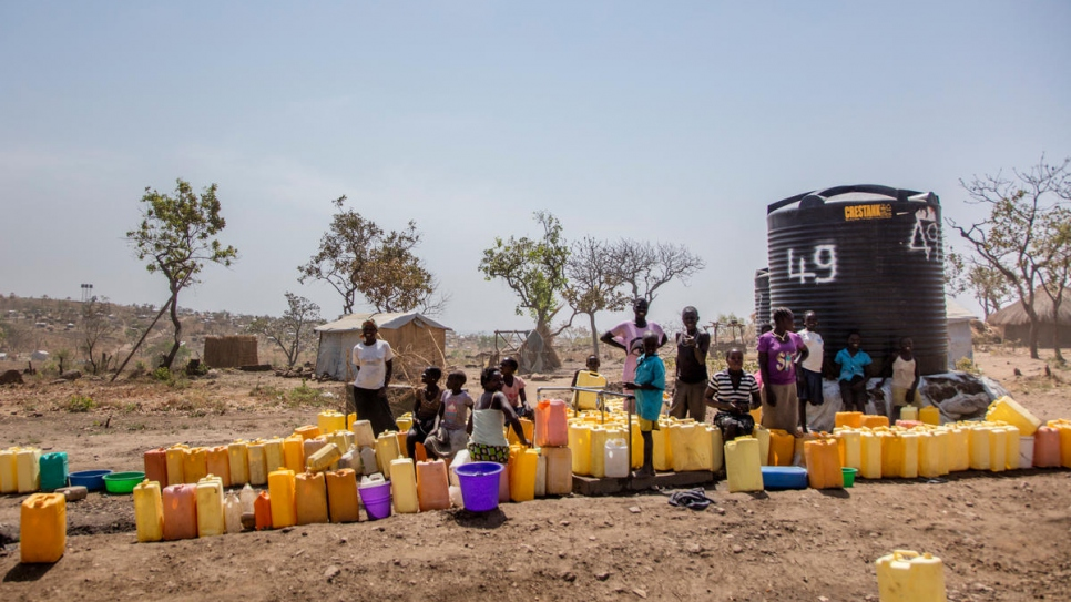 South Sudanese women at a water point in Rhino Camp refugee settlement in Uganda's Arua district where one in four people are refugees.