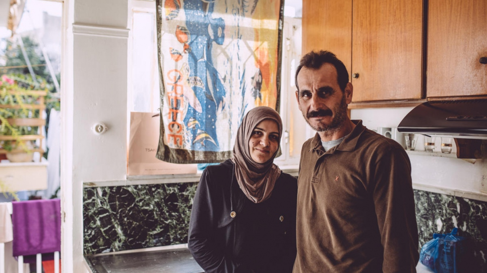 Ahmed Tarzalakis and his wife Jasmin in the kitchen of their apartment in Chania.