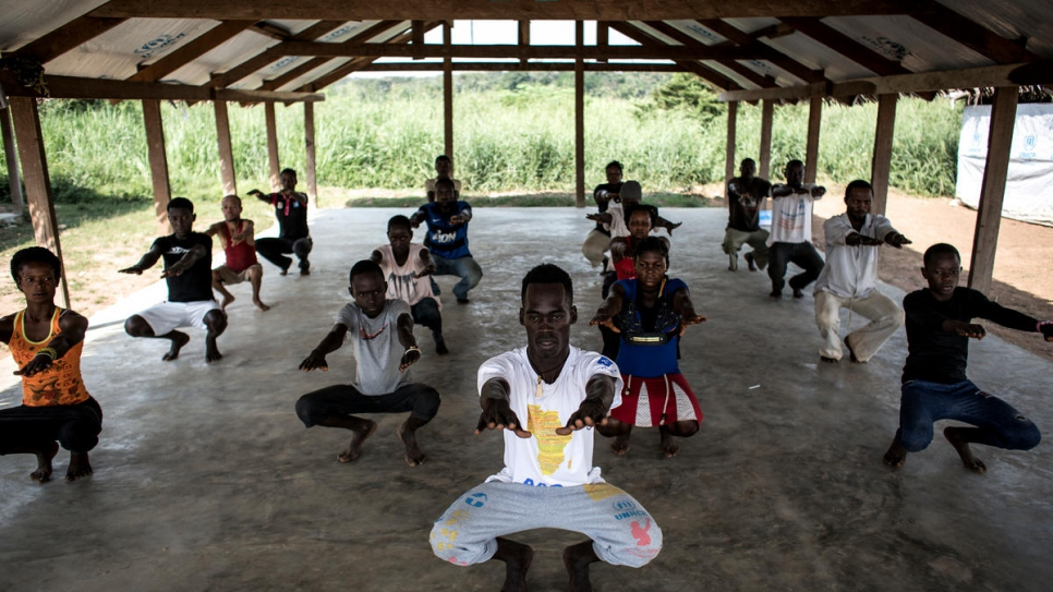 Refugee dancers warm up before taking part in a class at Inke Refugee Camp, Democratic Republic of the Congo.