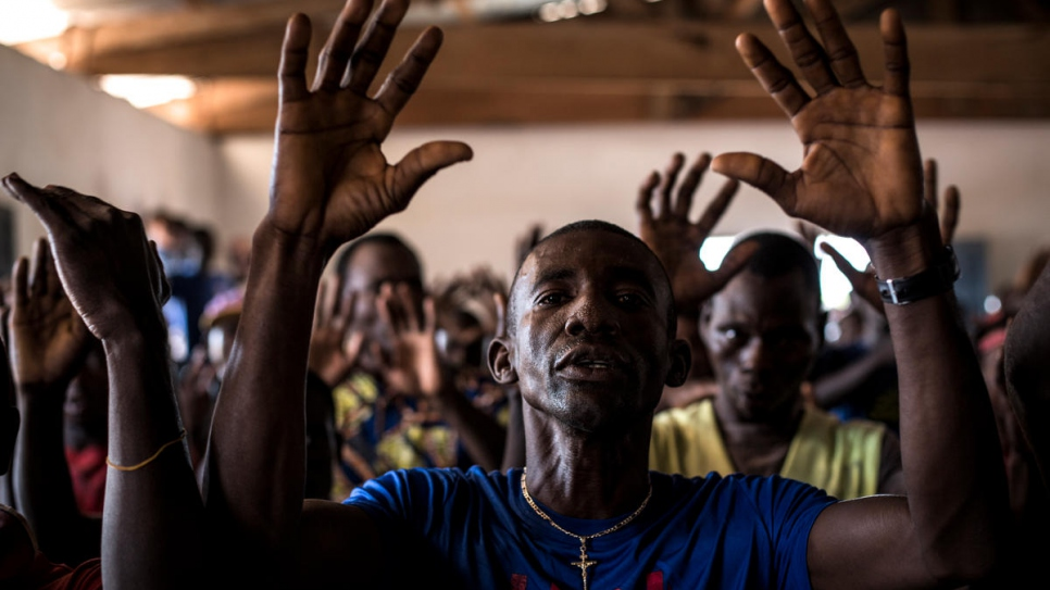 Refugees from the Central African Republic dance and sing as they take part in a choir class in Inke refugee camp, the Democratic Republic of the Congo.