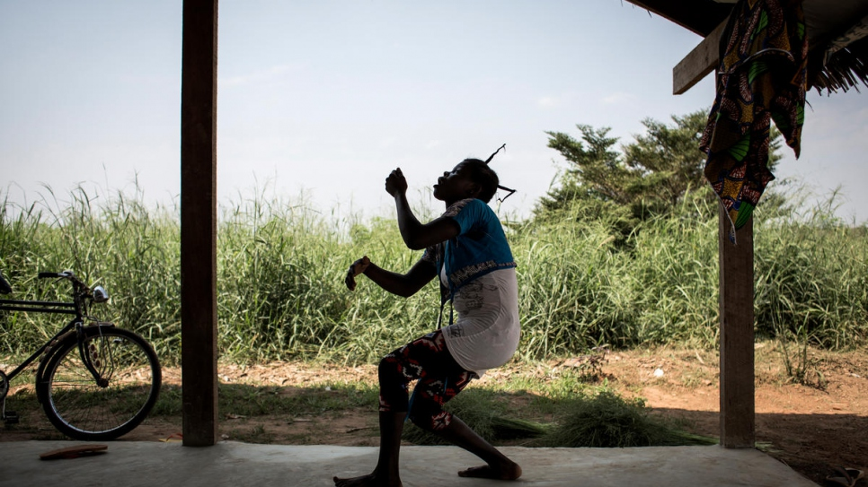 A refugee from the Central African Republic goes through some moves at a theatre dance class in the Inke Refugee Camp.