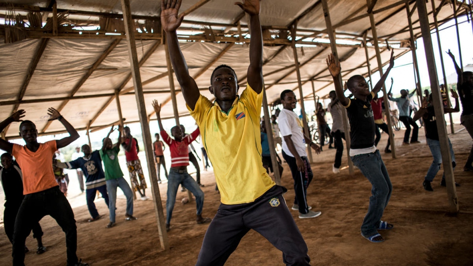 Central African refugees pose as they go through a HipHop dance routine.