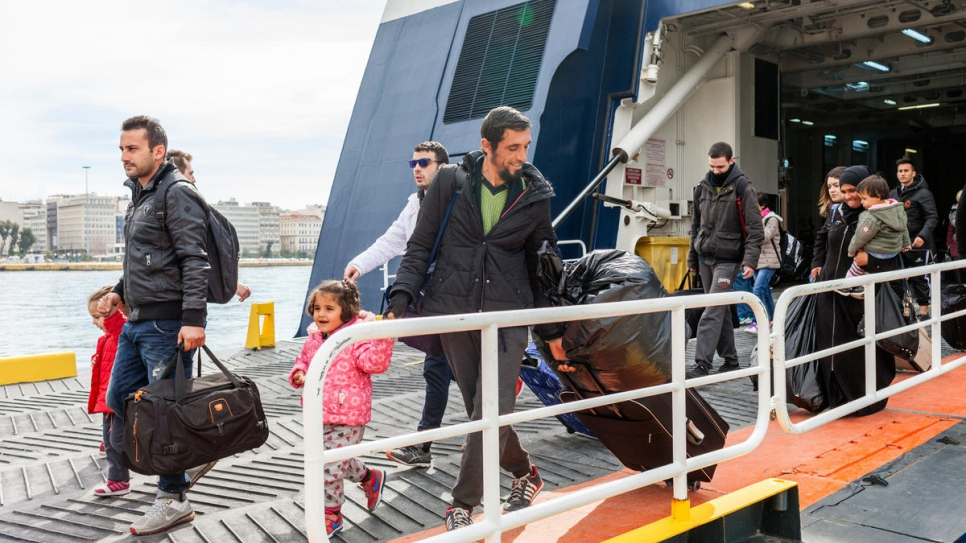 Mohamad Alhajer and his family arrive in the port of Piraeus from the island of Samos on their way to a new life on the Greek mainland.