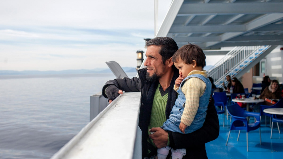 Mohamad Alhajer and his daughter Khadija, 2, on board the ferry taking them from the island of Samos to Piraeus on mainland Greece.