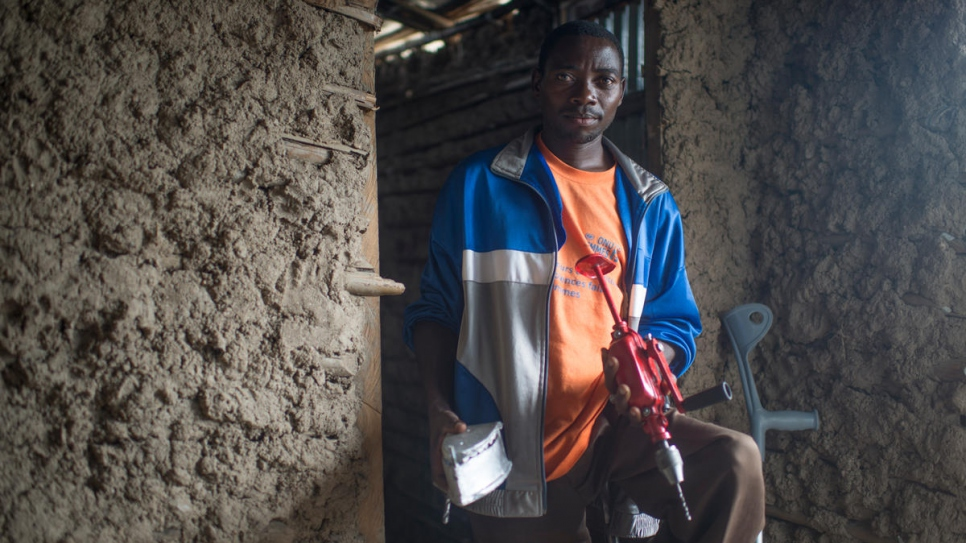 "Mathias Nzorigendera, 38, is president of the ""Dufashanye"" association. He helps handicapped Burundian refugees make household items utensils from scrap metal."