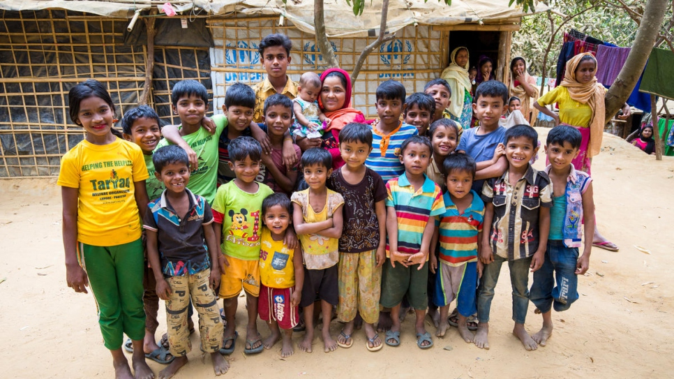 Khaleda Begum (in red scarf) at her home surrounded by refugee children now living on her farm.