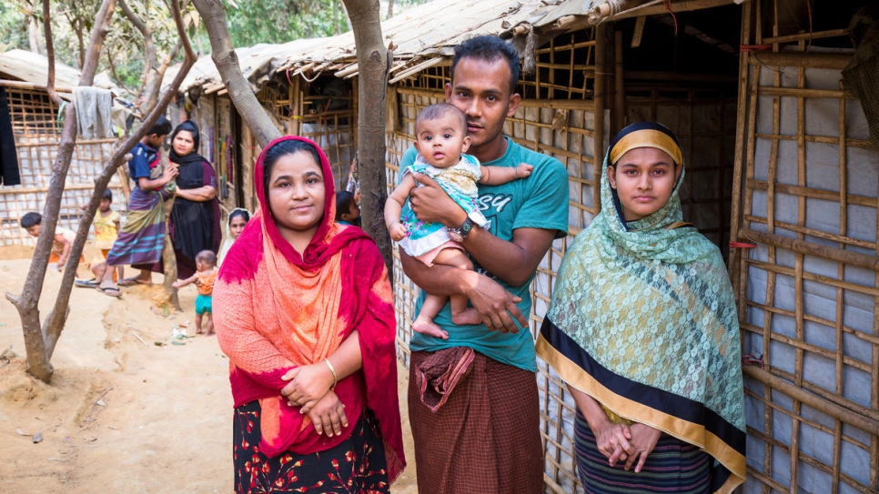 Khaleda Begum (left) with Mohammed Kausar, his wife Safita Begum and daughter Rumi.  Khaleda allowed the family to stay on her farm when they arrived from Myanmar.