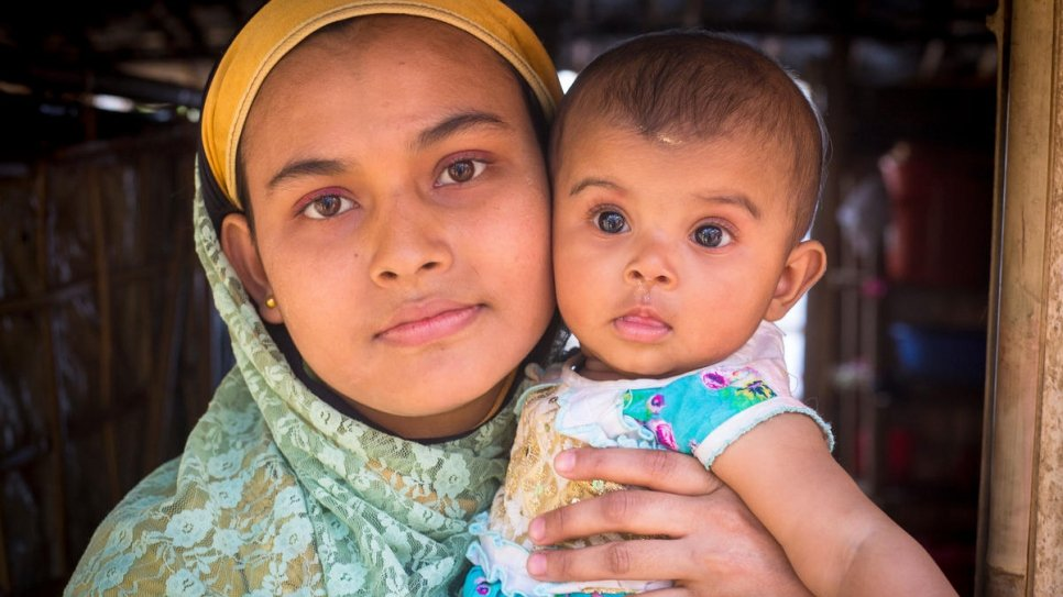 Safita Begum holding her baby daughter, Rumi.  Khaleda Begum allowed Safita and her husband Mohammed Kausar to stay on her farm after they arrived. Rumi was born days later.