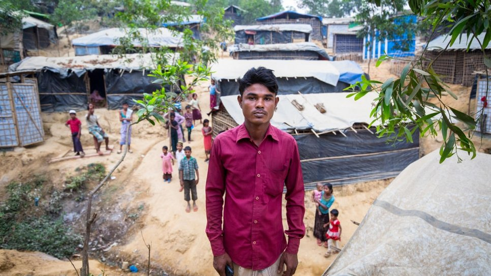 Mohammed Karim stands in part of his farm now used to house Rohingya families in makeshift shelters.