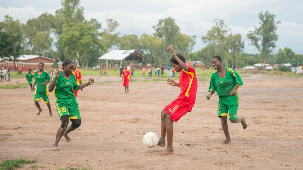 Morning Stars captain Emerance fends off her team's opponents in a match at Lusenda refugee camp.
