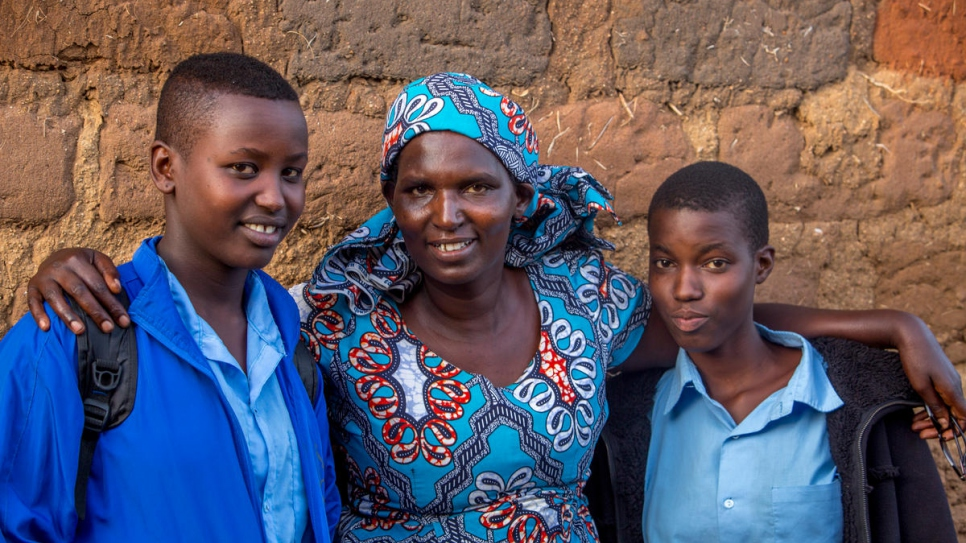 Bellaca's mother, Compare Yolande (middle), outside of her home in Mahama Refugee Camp, Kirehe.