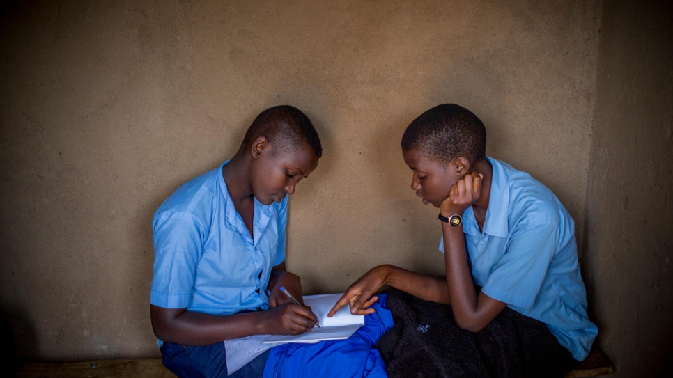 Anethe Cyuzuzo (left), 15, from Rwanda, and Irikungoma Bellaca (right), 16, from Burundi are best friends at Paysannat L school, in Mahama refugee camp, Kirehe, eastern Rwanda.