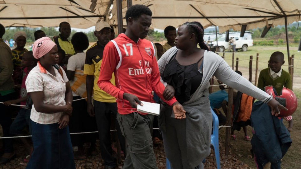 Jenipher helps to manage the crowd at the verification exercise.