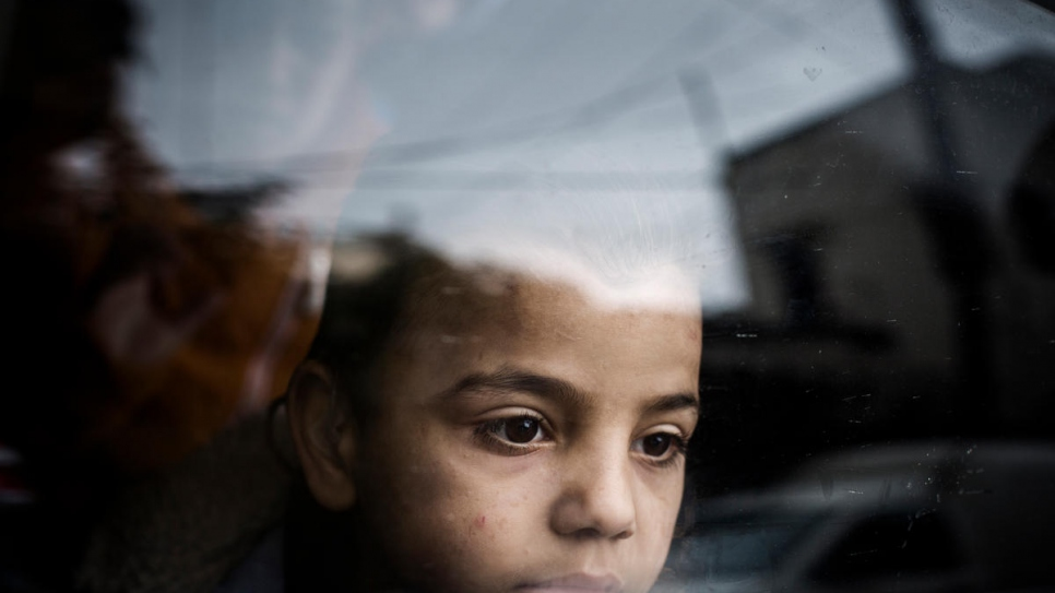 Mohammad gazes out of a window on the outskirts of Beirut in Lebanon.