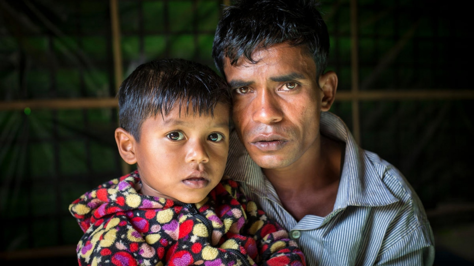 Mohammad Ayub, 31, and his daughter Kismat Ara, 3, pose for a photo in the family's one-room shelter.