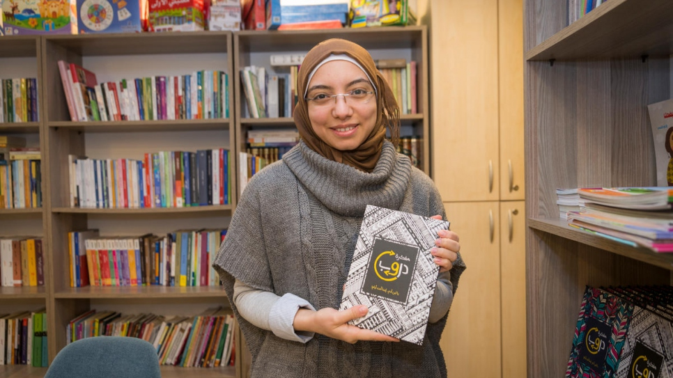 Syrian refugee Nada holds a creative diary that she designed and published, which she sells in her book cafe in Istanbul where other Syrian refugees come to read, buy and borrow Arabic books.