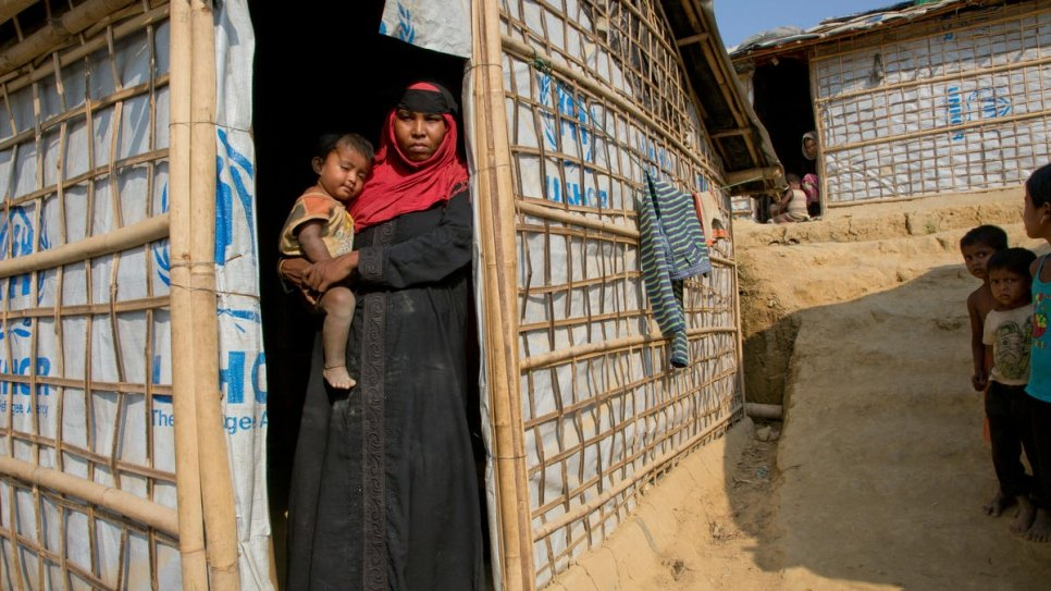 Rohingya refugee Jhura stands outside her shelter in Kutupalong settlement, Bangladesh.