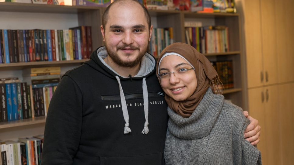 Nada, 27, and her fiancé Mohammad, 25, stand inside a book café they run together in Istanbul. Both originally from Syria, they met in Istanbul after Nada started a lending library offering Arabic books to the city's Syrian refugees.
