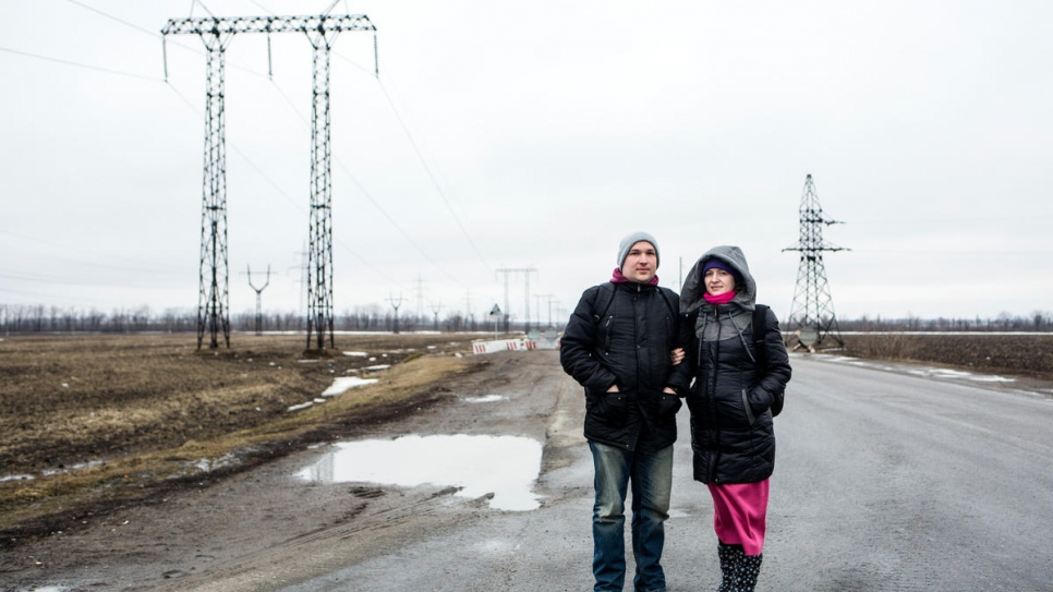 Sasha and Yulia near Mariinka checkpoint, on their way to see family.