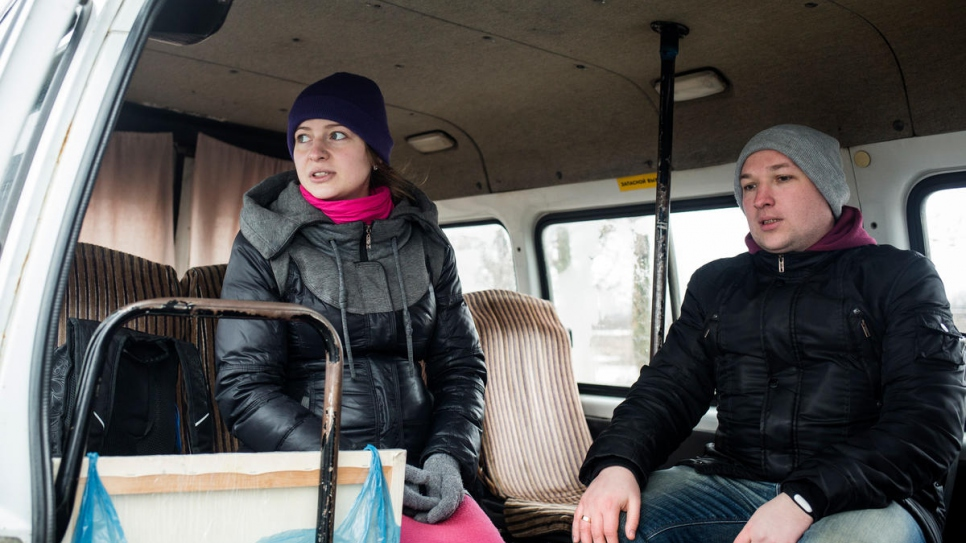 Yulia and Sasha wait on a minibus near the Mariinka checkpoint.