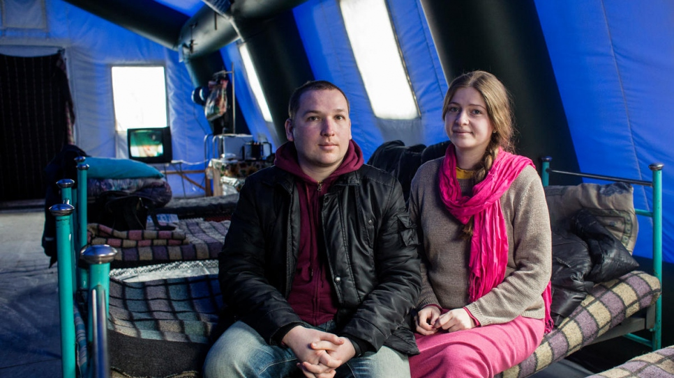 Sasha and Yulia wait in a heated tent at Mariinka checkpoint.