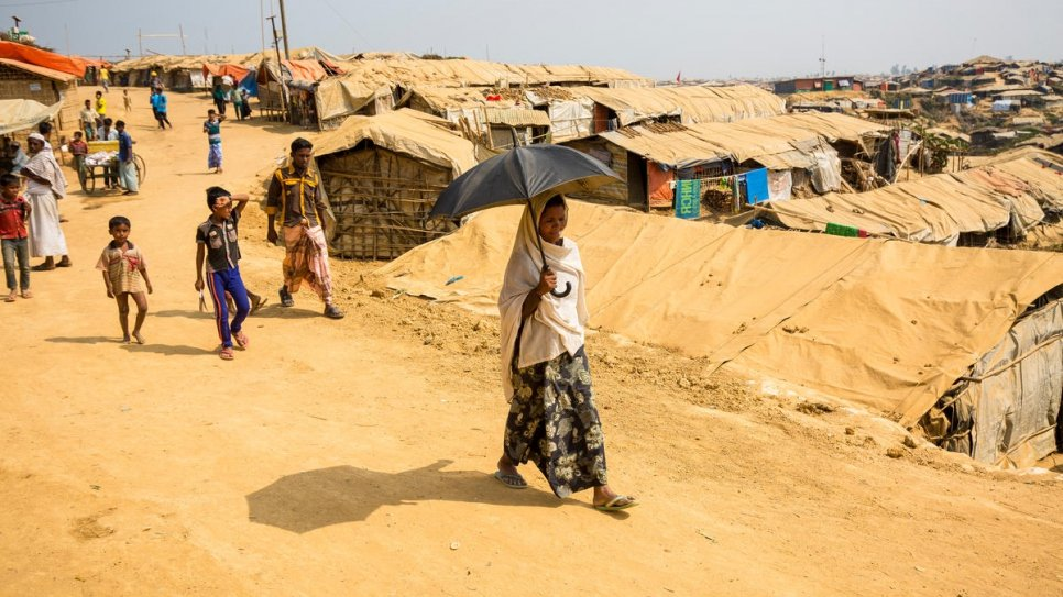 Sufia Khatun walks to her shelter in Kutupalong refugee settlement, Bangladesh.