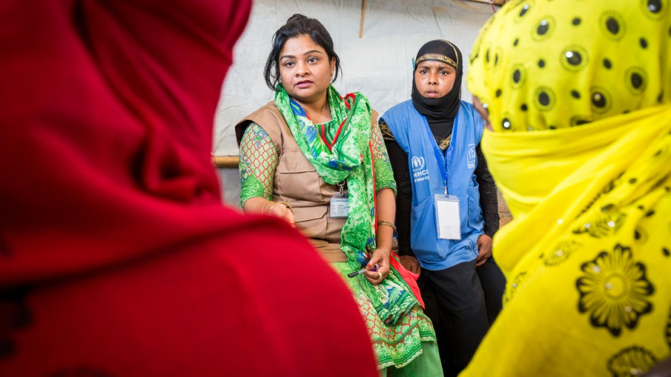 Fatama Islam, a Bangladeshi staffer with Technical Assistance Inc and Community Outreach Member Nur Bahara counsel Shamshidah and Mabia.