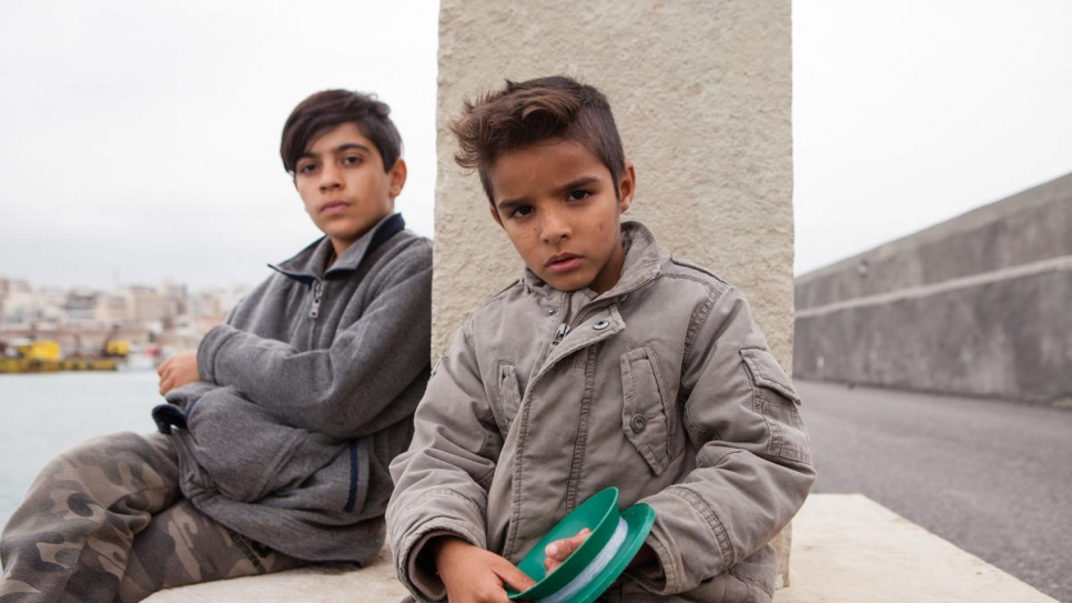Wahid, 12, and Navid, 7, from Afghanistan, have been learning to fish at the port.