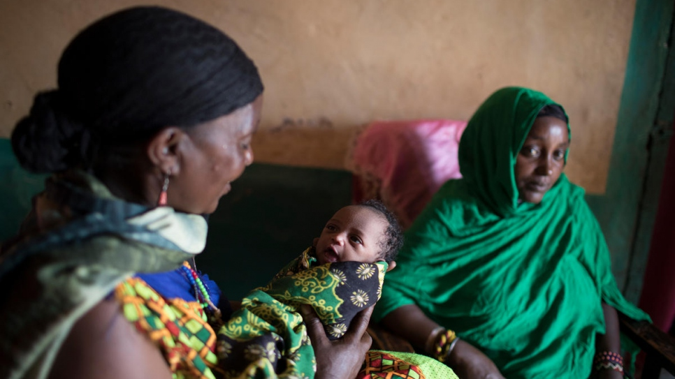 Sitting next to her daughter Malicha, Darmigalma cradles her grand daughter, Nuria. Only 48 hours after arriving in Moyale, Malicha went into labour with her 6th child.