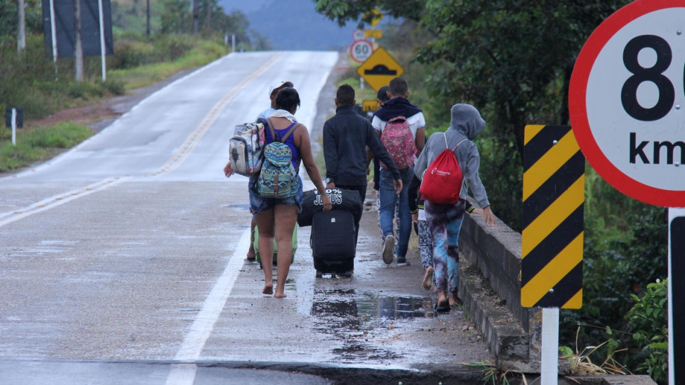 Venezuelans walk along the road from Pacaraima, Brazil, to Boa Vista, the capital of the border state of Roraima. Those who cannot afford public transport make the journey of over 200 kilometres on foot.