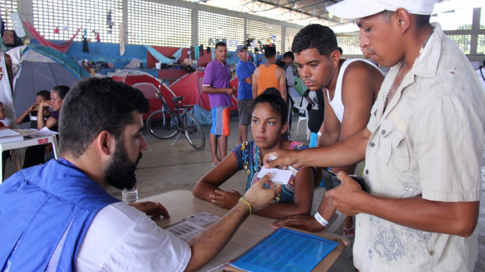 UNHCR Brazil and partners support local authorities to register Venezuelans living in Tancredo Neves Shelter, Boa Vista, Brazil.