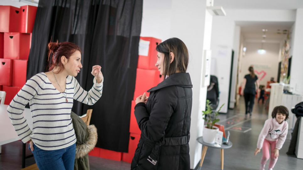Syrian instructor Rita Butman (left) talks to a student after class at the ReDI school.